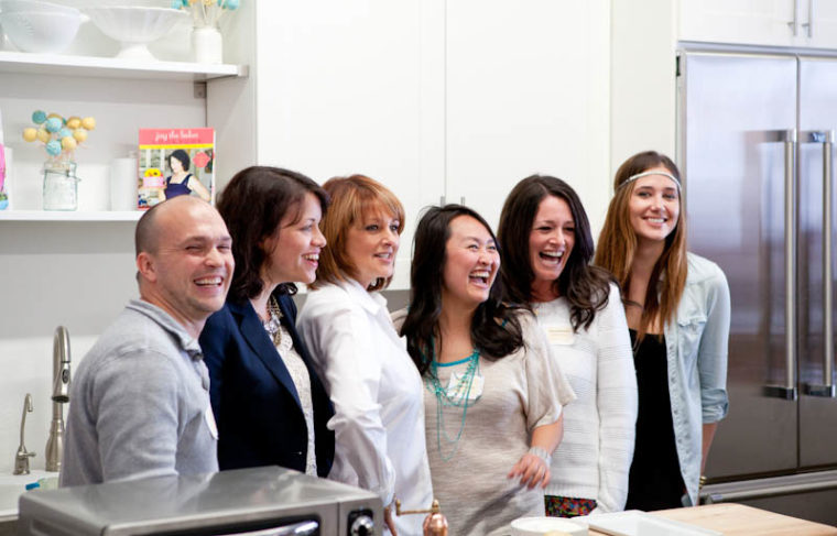 Todd, Joy, Cristina, Diane, KitchenAid represenative Rachel, and Alex standing in kitchen