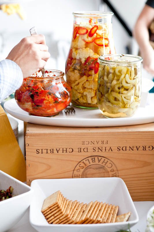 jars of pasta on wooden box with crackers