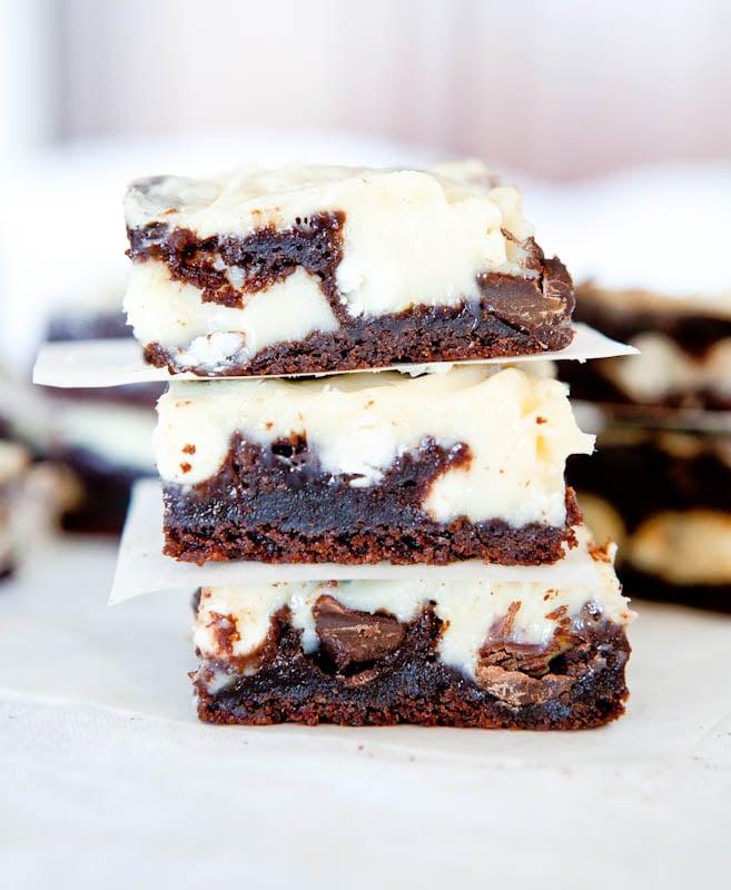 stack of three chocolate cream cheese cake bars