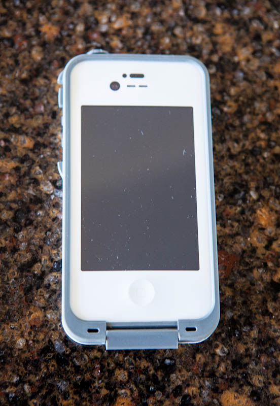 Old Iphone with blue lifeproof case