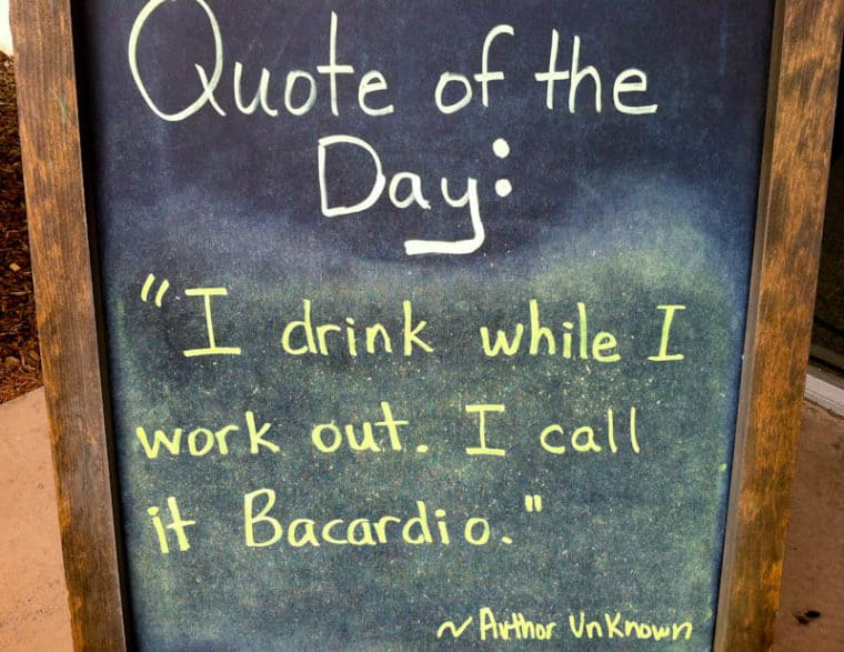 "Sign that says Quote of the Day: ""I drink while I work out. I call it Bacardio."""