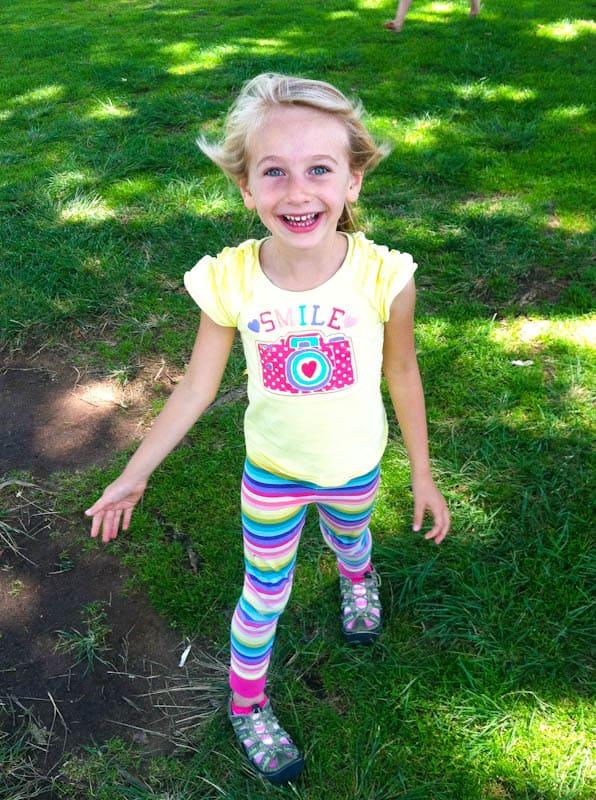 Skylar smiling in a grassy field