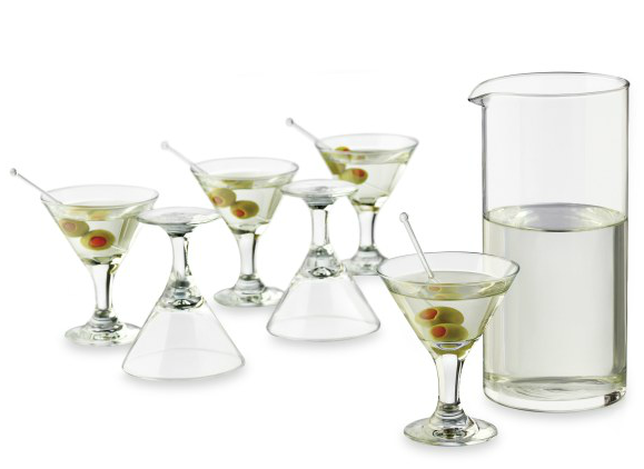 Set of martini glasses with four with cocktails in it and one pitcher