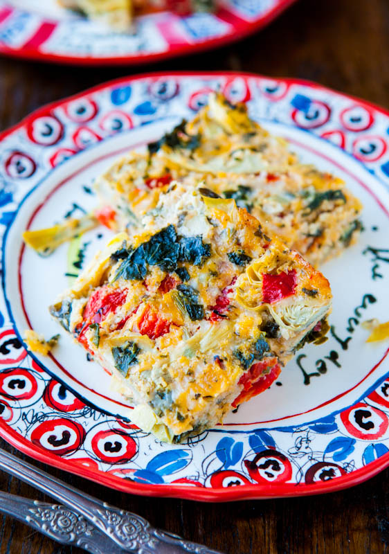 Spinach Artichoke and Roasted Red Pepper Cheesy Squares on patterned plate