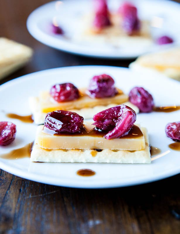 Roasted Grapes with Balsamic Reduction and cheese and crackers