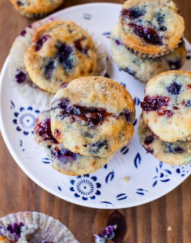 Blueberry Muffins with Raspberry Jam Swirls stacked