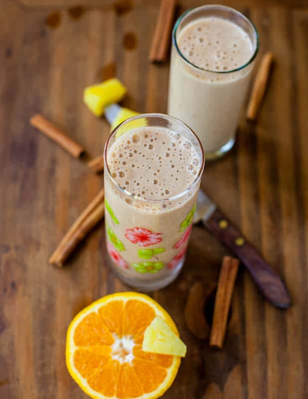 Citrus and Spice Smoothies with cinnamon sticks around