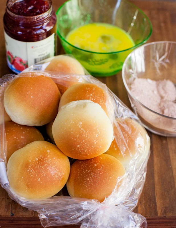 White dinner rolls, jelly, eggs, and dry ingredients