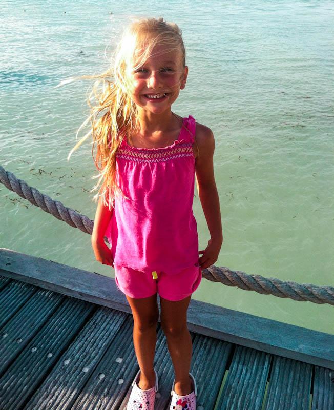Skylar standing on boat smiling