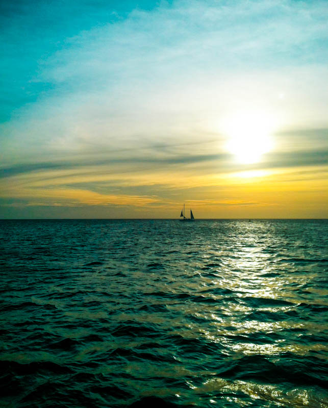Aruba ocean with horizon sunset and sailboat