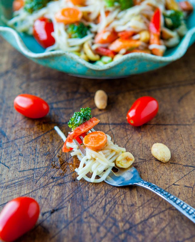 Peanut Noodles with Mixed Vegetables and Peanut Sauce on fork