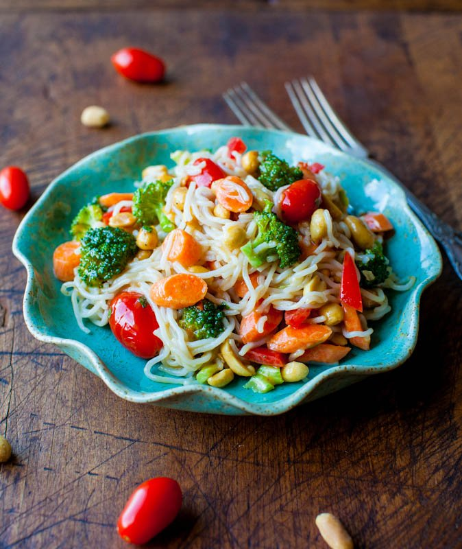 Peanut Noodles with Mixed Vegetables and Peanut Sauce in blue bowl