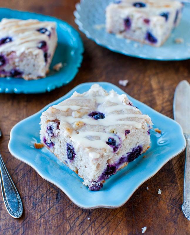 Blueberry Yogurt Cake with Lemon Vanilla Glaze on blue plate