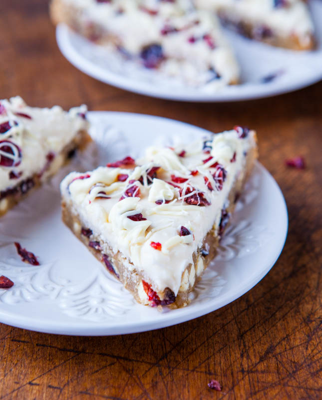 two copycat starbucks cranberry bliss bars on a white plate