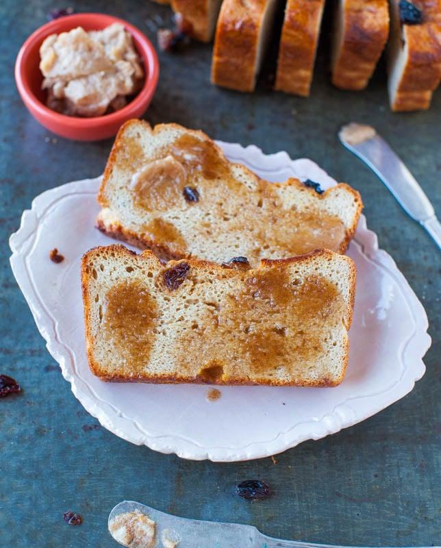 two slices of cinnamon raisin english muffin bread on white plate