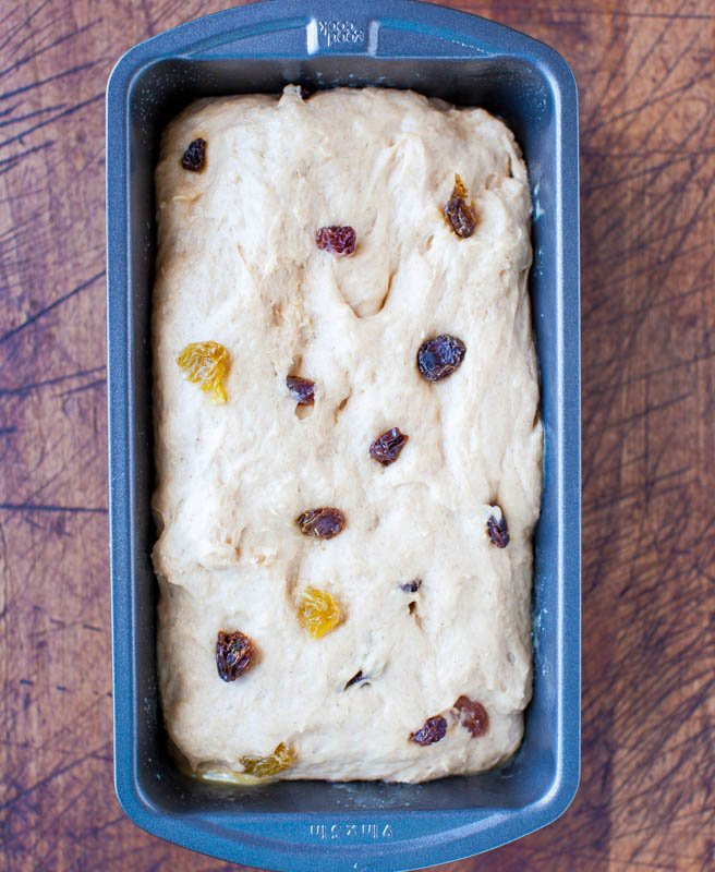 unbaked loaf of cinnamon raisin bread in bread pan