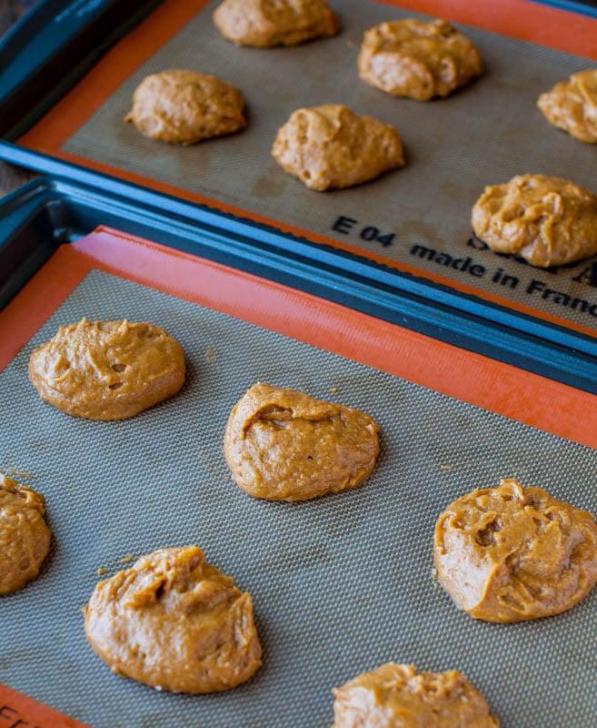 Pumpkin tops and bottoms on baking sheet