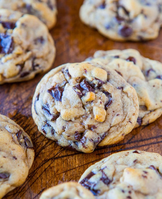 chunky chocolate chip cookies on wood surface