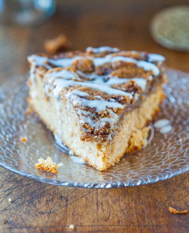 Cinnamon Roll Coffee Cake with Cream Cheese Glaze on a clear glass plate