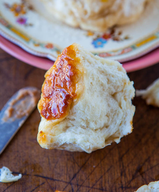 The Best Soft and Fluffy Honey Dinner Rolls - Soft, fluffy rolls brushed with sweet honey butter! Truly the best dinner rolls ever. They disappear so fast at holiday meals & parties!