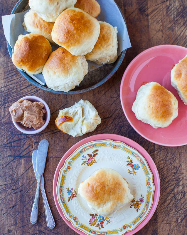 Overhead picture of Honey Dinner Rolls on a white and pink plate