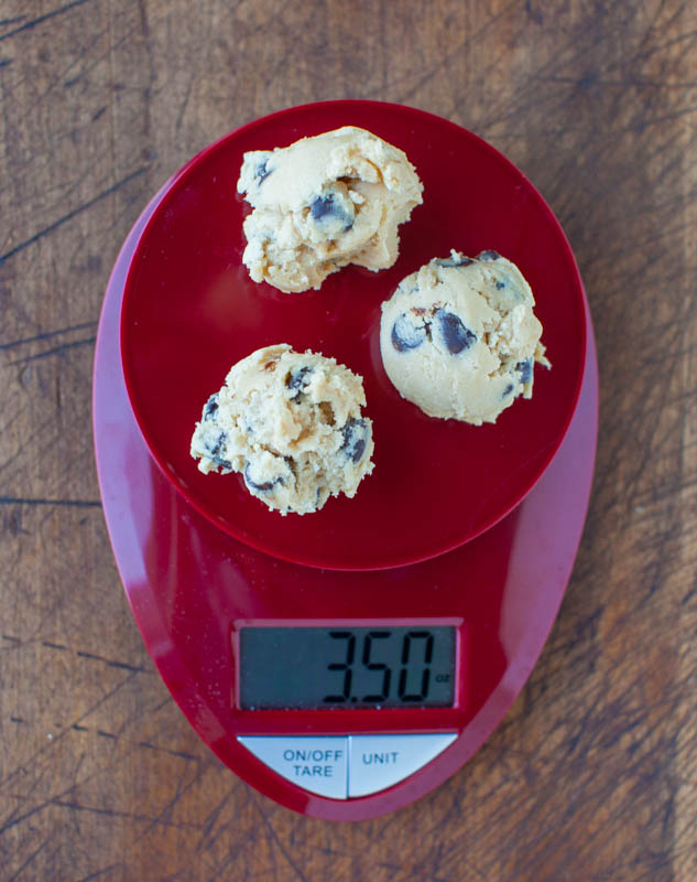 three cookie dough balls on scale with 3.5 ounces