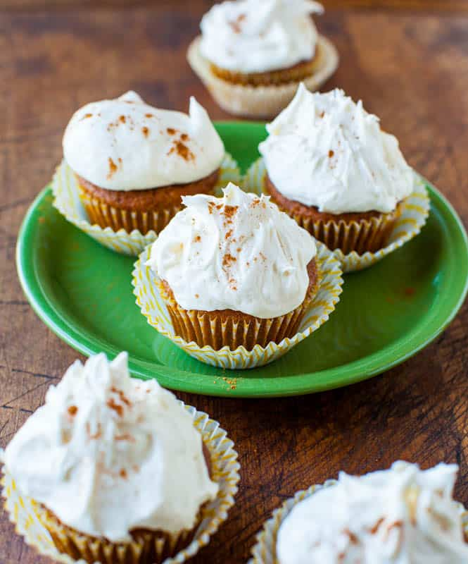 Pumpkin Spice Cupcakes with Marshmallow Buttercream Frosting on green plate