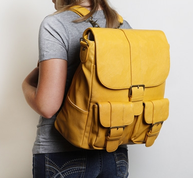 Woman wearing camera bag