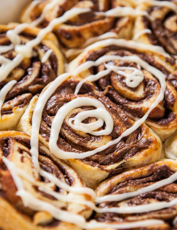 Close up of baked and glazed Nutella Cinnamon Rolls