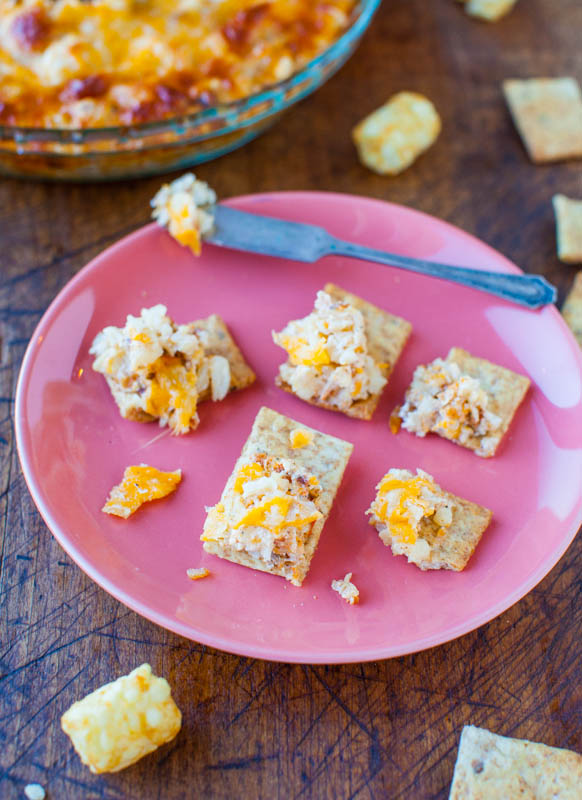 Loaded Potato Dip—My favorite baked potato toppings, all loaded into this cheesy dip! This easy party dip is made with tater tots, sour cream, meatballs, and cheese!!