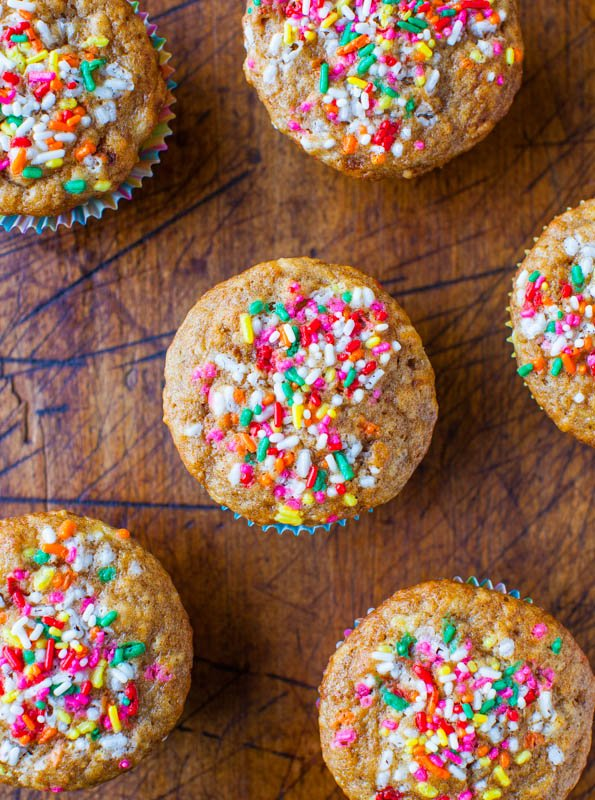 overhead shot of six moist banana muffins topped with sprinkles