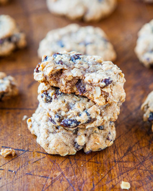 Stacked Thick and Chewy Oatmeal Raisin Cookies with one having a bite taken out