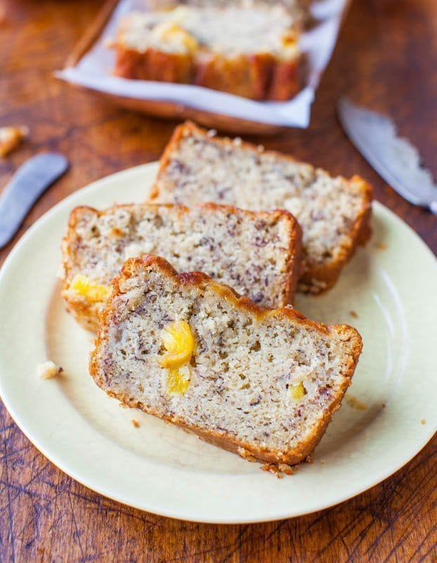 three slices of Banana Pineapple Bread on white plate