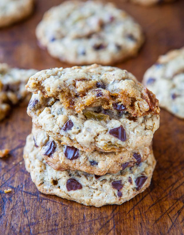 Slice-and-Bake Oatmeal Raisin Chocolate Chip Cookies stacked with half of cookie on top showing center