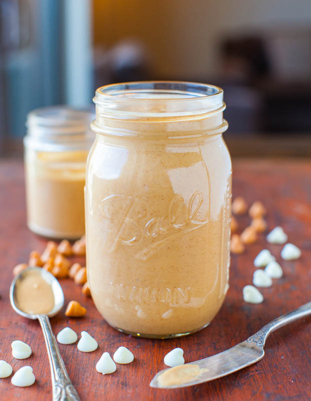Side view of Homemade Honey Roasted Butterscotch White Chocolate Peanut Butter in jar