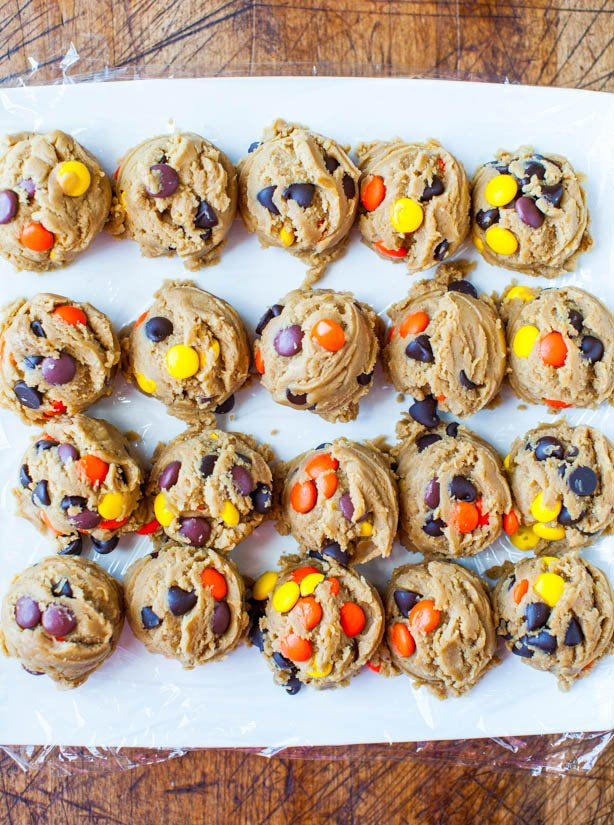 overhead view of unbaked Reese's Pieces peanut butter cookie dough balls
