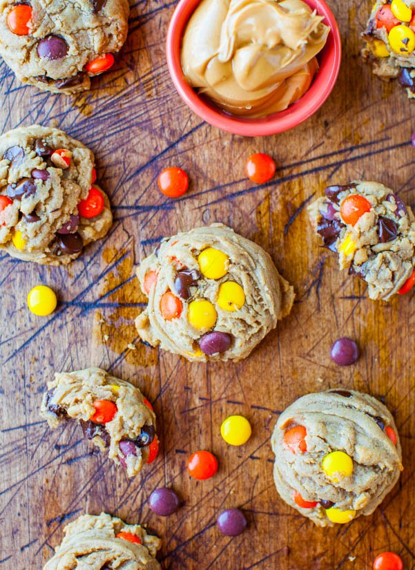 overhead view of Reese's pieces cookies next to a small bowl of peanut butter