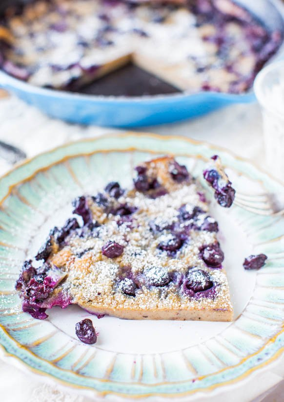 slice of blueberry dutch baby pancake on a plate