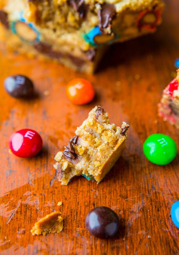 Triple Peanut Butter Monster Cookie Bars - Soft, gooey bars loaded with M&Ms, chocolate and made for serious peanut butter lovers! So good!