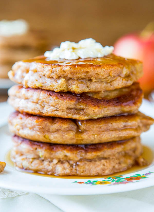 stack of fluffy apple pancakes topped with butter
