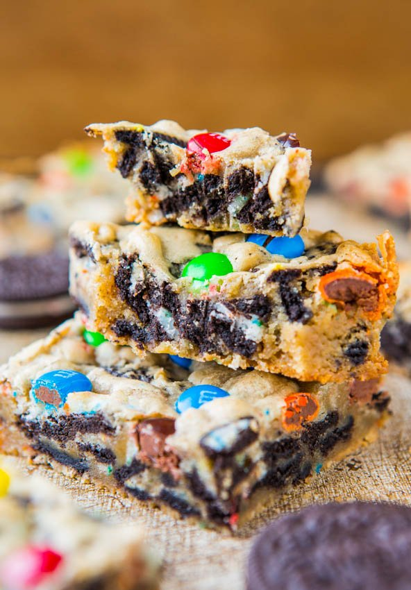 Loaded M&M Oreo Cookie Bars - Stuffed to the max with M&Ms and Oreos! Easy, no-mixer recipe that's ready in 30 minutes. Always a hit at parties!
