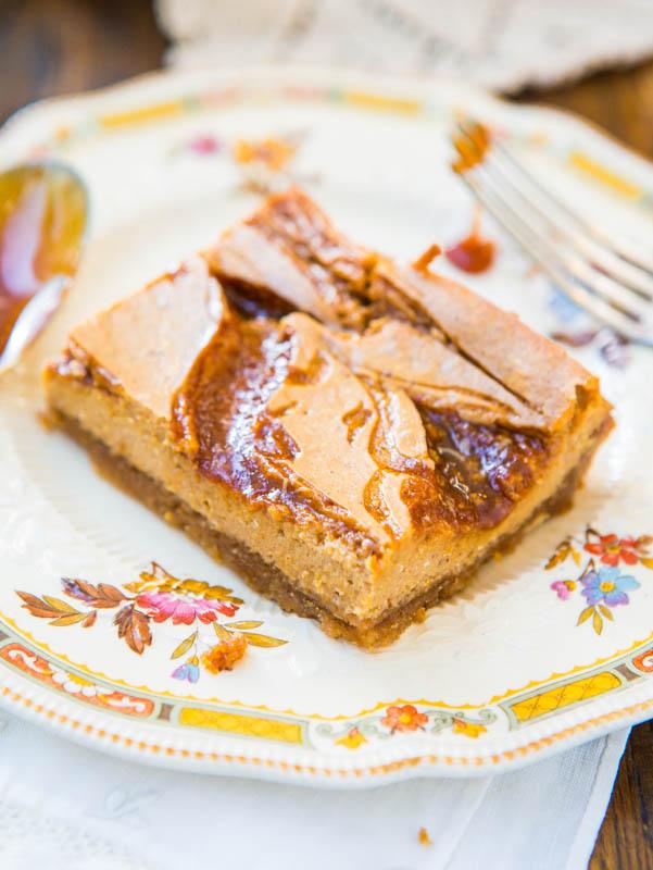 Salted Caramel Pumpkin Swirl Cheesecake Bars — These pumpkin cheesecake bars are a texture lover's dream with a crisp brown sugar-graham cracker crust, a soft yet dense pumpkin cheesecake layer, and gooey soft salted caramel swirls the run like a river over the surface.