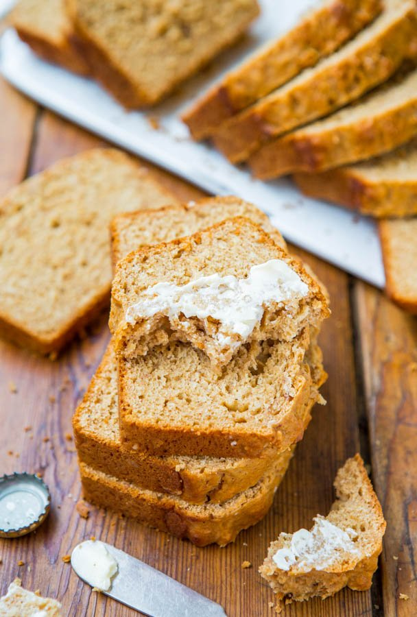 Sliced and stacked Honey Maple Beer Bread with butter