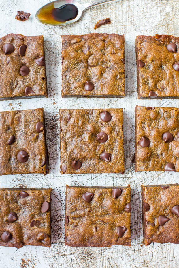 Soft and Chewy Gingerbread Molasses Chocolate Chip Bars - Dense, rich and like eating a piece of molasses fudge. Easy no-mixer recipe at averiecooks.com