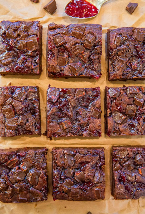 Chocolate Cherry Chocolate Chunk Fudgy Brownies - Scratch brownies as fast and easy as using a mix, and loaded with bold chocolate flavor and sweet cherry jam! Easy recipe at averiecooks.com