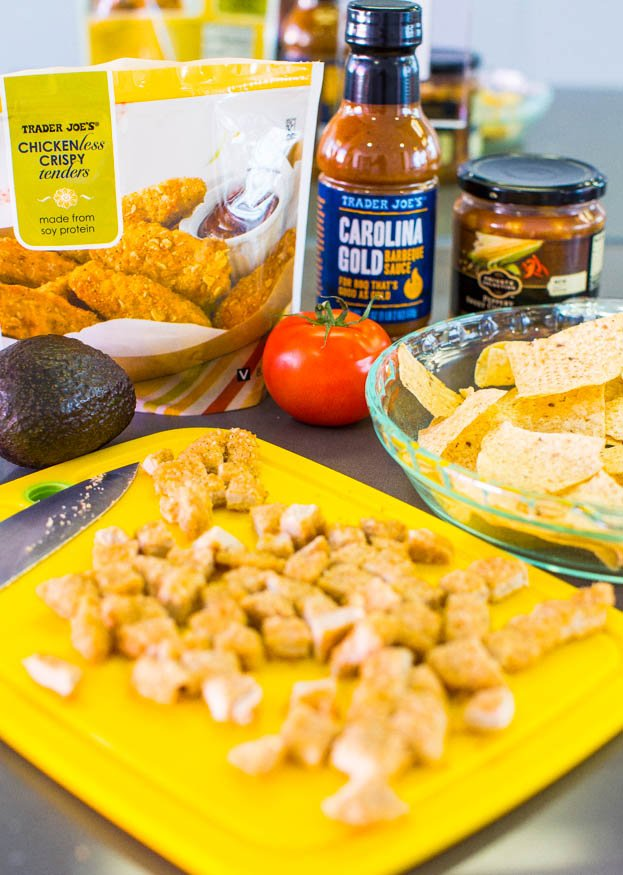 Loaded BBQ Chicken Nugget Nachos (with vegan/GF options) - Chicken nuggets coated in BBQ sauce on top of cheesy nachos. Perfect party food!