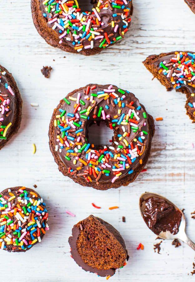 Baked Chocolate Donuts with Chocolate Ganache and Sprinkles - Making donuts at home is as easy as making muffins! They're baked rather than fried so you can have seconds, of course!