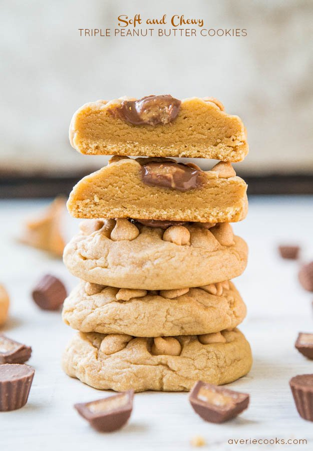 stack of four peanut butter cup cookies. the top cookie has been cut in half.