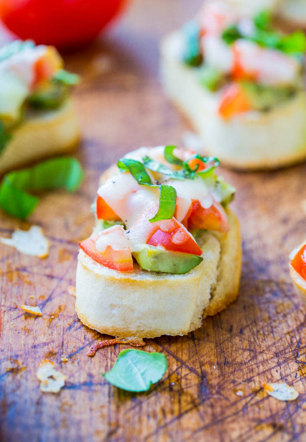 Avocado, Tomato, and Mozzarella Crostini - Like bruschetta, but with avocado & who can say no to avocado and cheese! A fast & easy appetizer everyone loves & ready in 15 minutes!