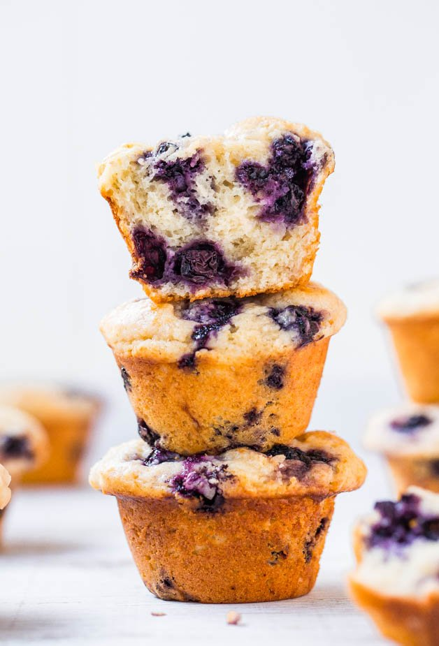 three blueberry muffins from scratch stacked on top of each other
